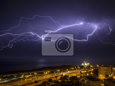 Wall mural lightning over the city