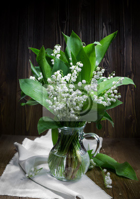 Lilies of the valley in a  pitcher.