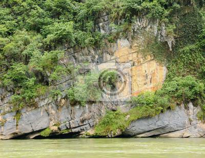 Limestone rock and vegetation over river