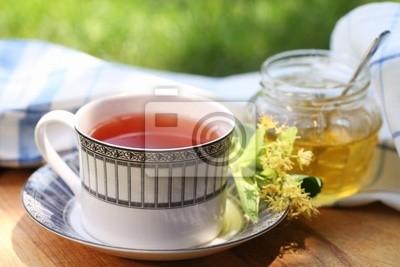Linden honey in a jar with linden flowers