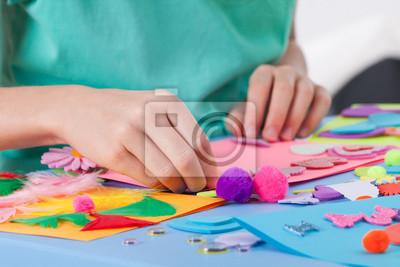 Wall mural Little boy making crafts