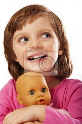 little girl with toy doll