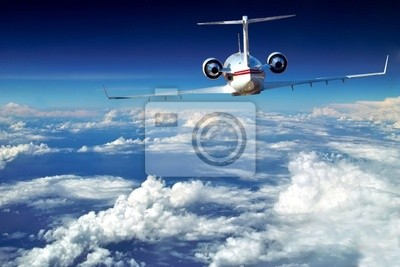 Luxury airplane above sky, clouds