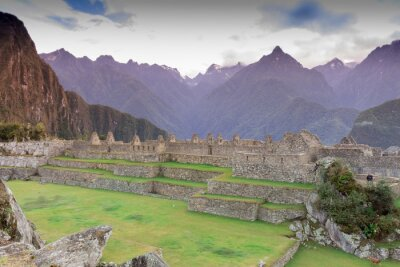 Wall mural Machu Picchu, Cusco, Peru in the early morning mist, found on the steep slopes of the Andes Mountains.