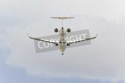 Wall mural MADRID, SPAIN - FEBRUARY 14th 2015: Aircraft -Bombardier CRJ-900-, of -Iberia- airline, is landing on Madrid-Barajas -Adolfo Suarez- airport, on February 14th 2015.