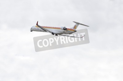 Wall mural MADRID, SPAIN - JUNE 14th 2015: Aircraft -Bombardier Canadair CRJ-1000-, of -Air Nostrum- airline, is taking off from Madrid-Barajas -Adolfo Suarez- airport, on June 14th 2015.