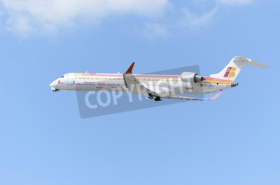 Wall mural MADRID, SPAIN - JUNE 14th 2015: Aircraft -Bombardier Canadair CRJ-900-, of -Air Nostrum- airline, is taking off from Madrid-Barajas -Adolfo Suarez- airport, on June 14th 2015.