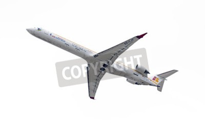 Wall mural MADRID, SPAIN - MAY 3th 2015: Aircraft -Bombardier Canadair CRJ-1000-, of -Air Nostrum- airline, is taking off from Madrid-Barajas -Adolfo Suarez- airport, on May 3th 2015.