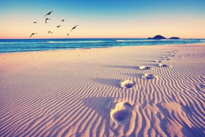 Wall mural magische Fußspuren im Sand