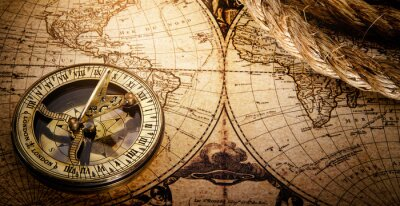 Magnetic old compass on world vintage map 18 century.Travel, geography, navigation, tourism and exploration concept wide background.