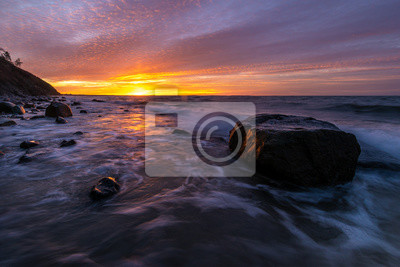 Magnificent, spectacular sunset over the sea. The Baltic Sea, Wolin National Park, Poland