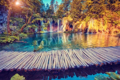 Wall mural Majestic view on turquoise water and sunny beams in the Plitvice Lakes National Park, Croatia