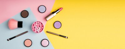 Wall mural Makeup products and decorative cosmetics on color background flat lay. Fashion and beauty blogging concept. Long web format for banner