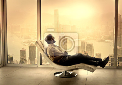 Man relaxing on a chaise longue