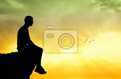 man sitting on the rock