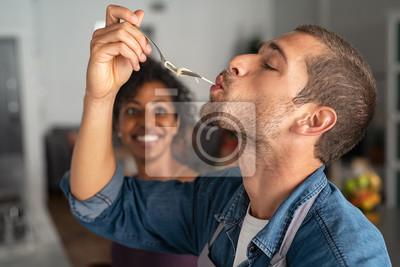 Wall mural Man tasting spaghetti