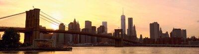 Wall mural Manhattan skyline panorama with Brooklyn Bridge at sunset, New York, United States