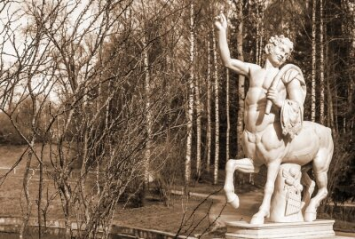 Marble sculpture of  centaur (copy) on  bridge in Pavlovsky Park. Sepia