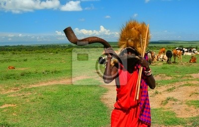 Wall mural Masai warrior playing traditional horn