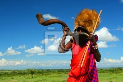 Wall mural Masai warrior playing traditional horn