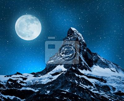 Matterhorn in night sky with moon - Swiss Alps