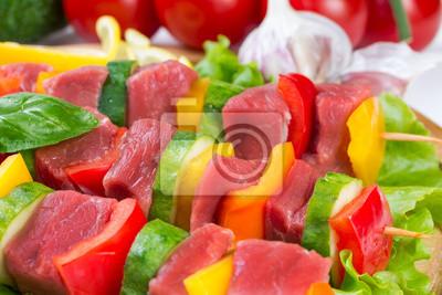 Meat on skewers on salad leaves