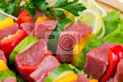 meat with vegetables on salad leaves