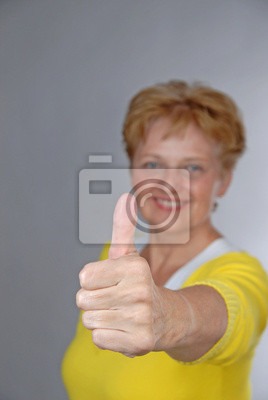 mid aged smiling woman with OK gesture