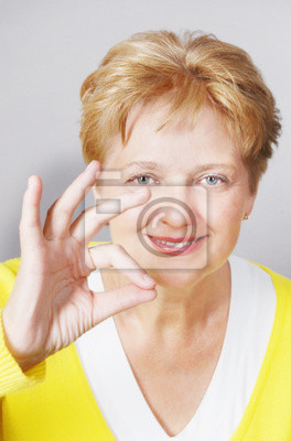 mid aged woman with OK gesture