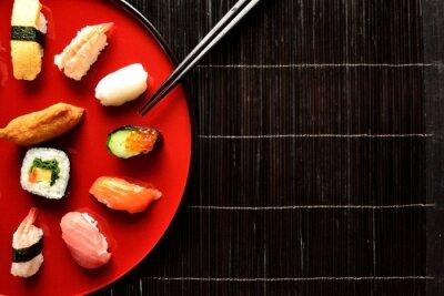 Wall mural Mixed sushi platter with chopsticks