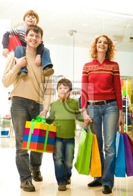 Modern family going shopping in trade center
