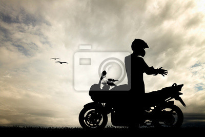 motorcyclist at sunset