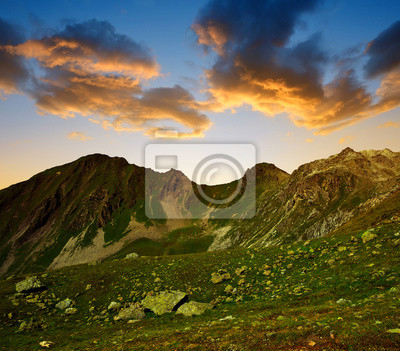Mountain landscape in Switzerland Alps at sunset - canton Graubunden.