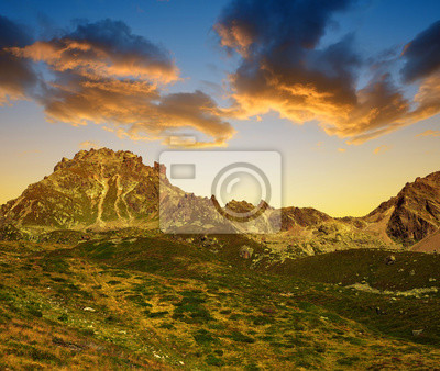 Mountain landscape over Davos in Switzerland Alps at sunset - canton Graubunden.
