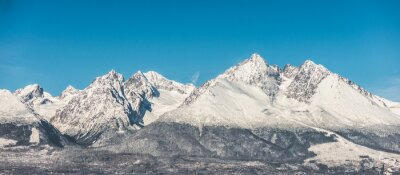 Wall mural Mountain landscape, snow covered high mountains and blue sky