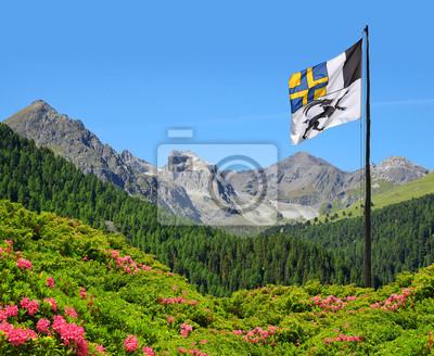 Mountain landscape with Graubunden canton flag  - Park Ela, Switzerland