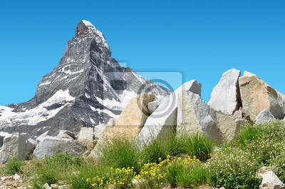 Mountain landscape with views of the Matterhorn peak in Pennine alps, Switzerland.