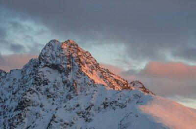 Wall mural Mountain sunset panorama at winter in High Tatras - Swinica peak on Polish - Slovakian border