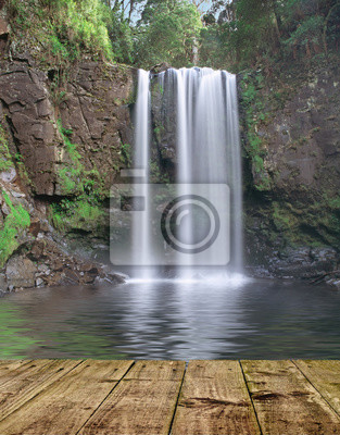Mountain waterfall with wooden pier