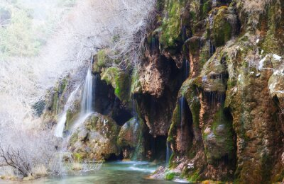 Wall mural Mountains stream through moss rocks