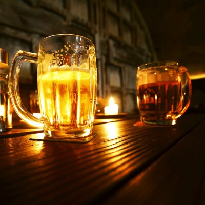 Wall mural Mugs of beer