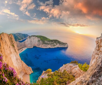Wall mural Navagio beach with shipwreck against sunset on Zakynthos island in Greece