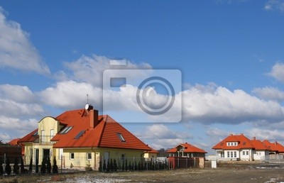 New, beautiful homes and blue sky. Poland.