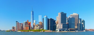 Wall mural New York City lower Manhattan financial  wall street district buildings skyline on a beautiful summer day with blue sky