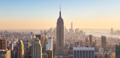 Wall mural New York City Manhattan skyline in sunset.