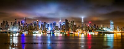 Wall mural New York City Panorama on a cloudy night as viewed from New Jersey across the Hudson River