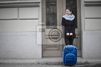 Nice girl waiting in front of a house