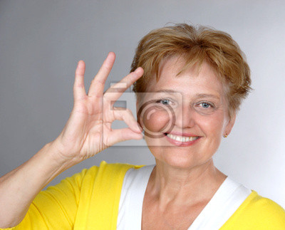 nice mid aged smiling woman with OK gesture