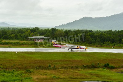 Wall mural Nok air Bombardier Dash 8 q 400 aircraft type take off for taxi at ranong airport in rainy day june 172558.