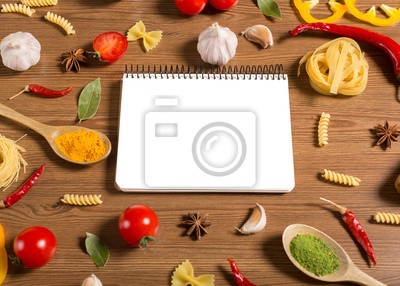 Wall mural notebook for recipes, vegetables and spices on wooden table